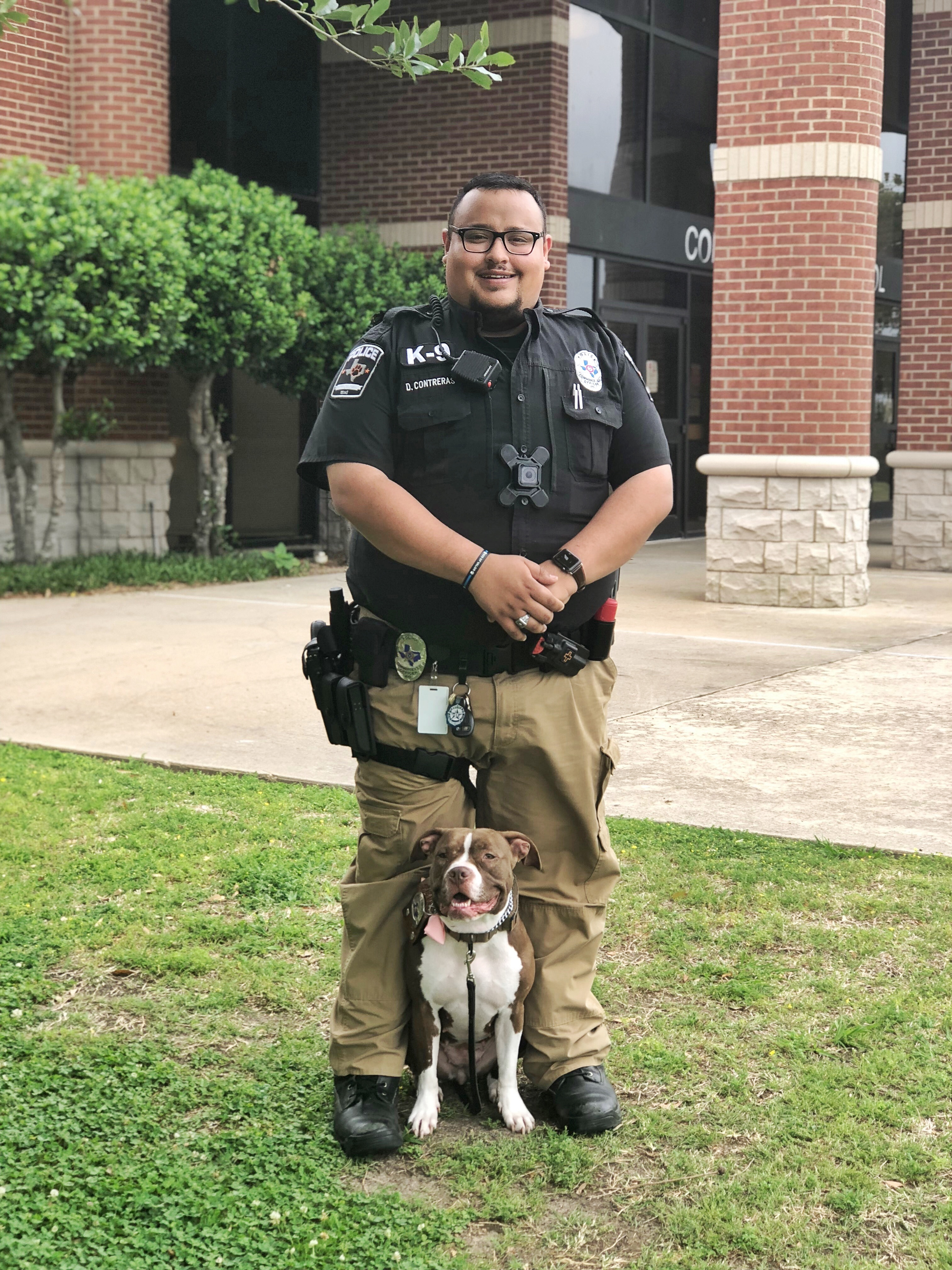 Officer Contreras and Coco.jpeg